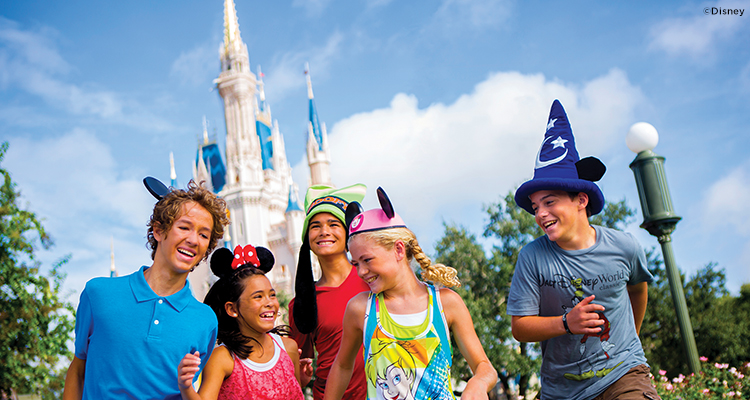 A family outside Cinderella's Castle in Walt Disney World in Florida