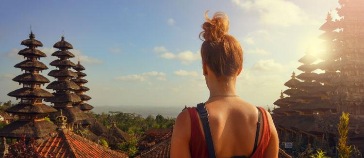Girl overlooking Bali temples