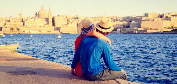 Happy couple admiring Malta harbour