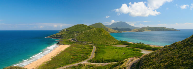 A view of the St Kitts landscape including hills and beach