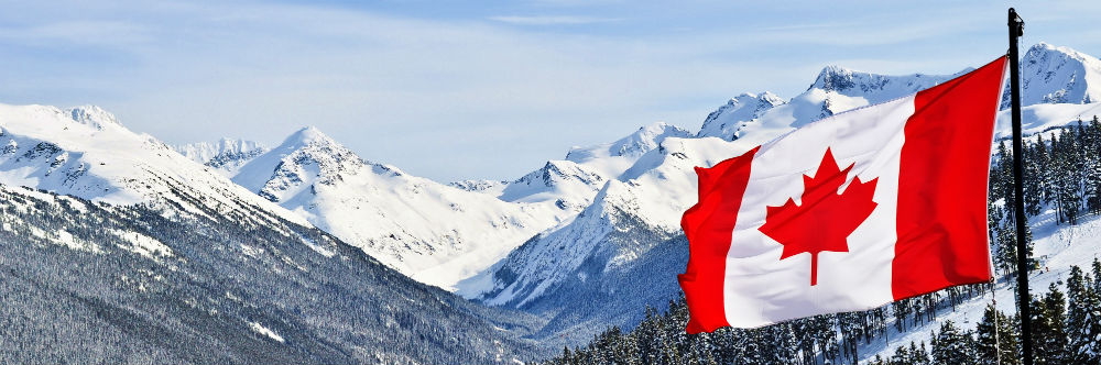 The Canada flag against snowy mountains