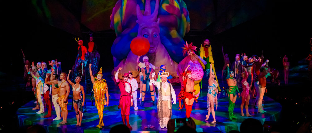 Cirque de Soleil®on stage in Las Vegas with purple and pink hued lighting.
