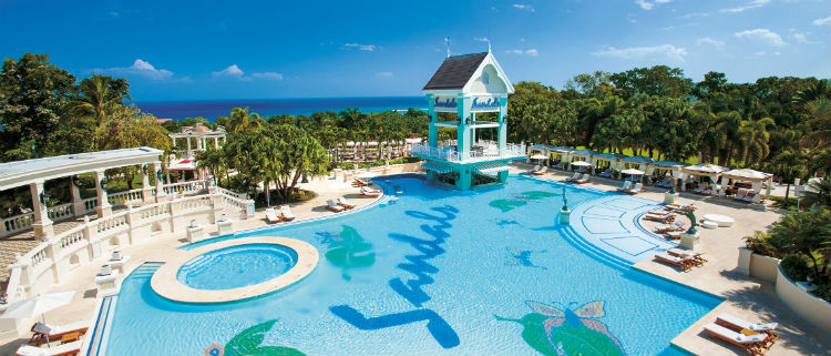 The pool area of Sandals Resorts in the Carribean. You can see the Sandals logo at the bottom of the pool.