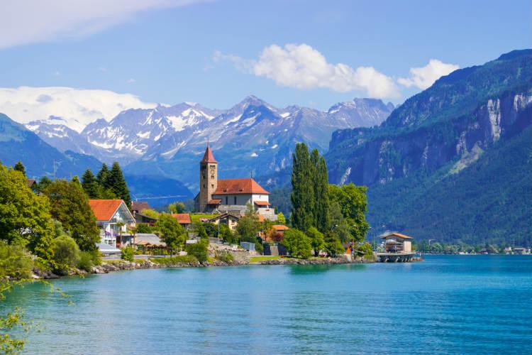 Panoramic view to the Brienz town on lake Brienz by Interlaken, Switzerland.