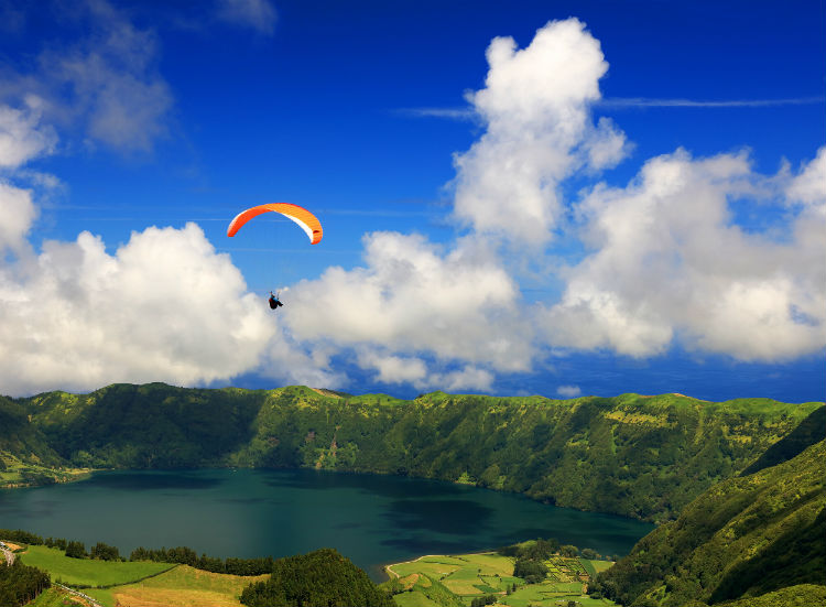 Someone paragliding over the Azores.