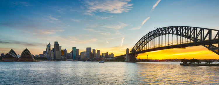 Sydney Harbour Bridge with a yellow and blue sunset.