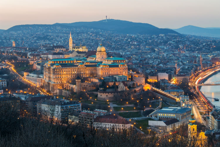 The Vienna skyline lit up from above
