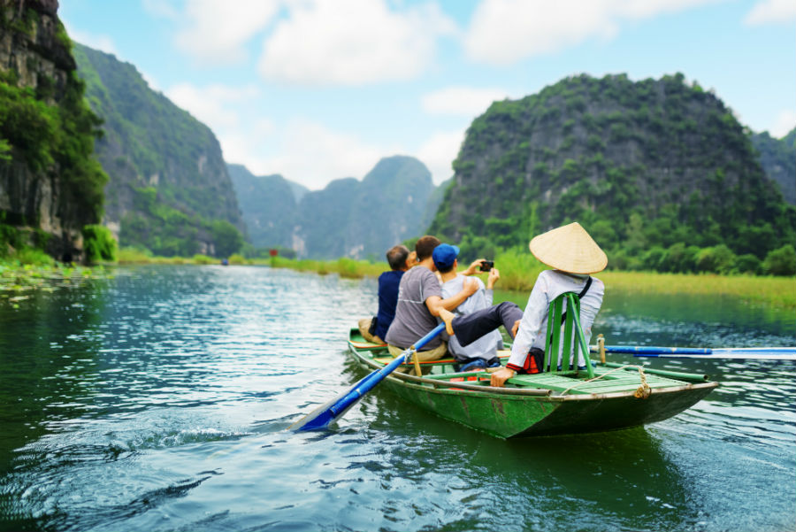 Tourists on a guided river boat tour in Vietnam