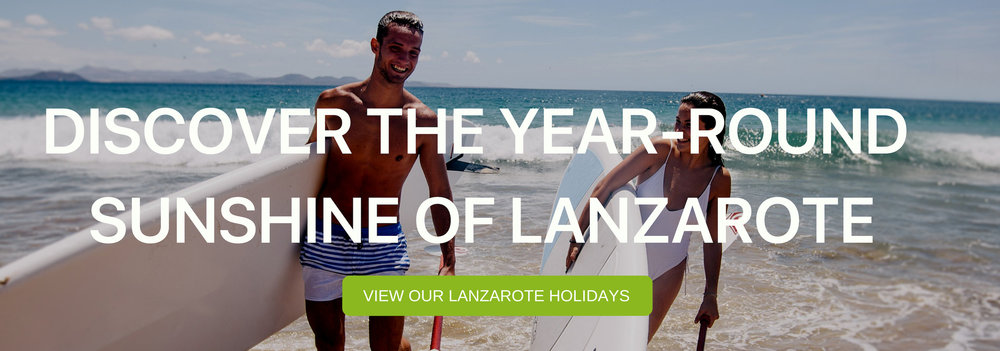 "A banner that says ""Discover The Year-Round Sunshine of Lanzarote"""