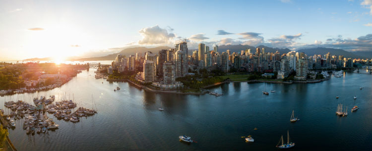 The skyline of Vancouver at sunset - one of the Canadian cities that is easy to visit from the USA