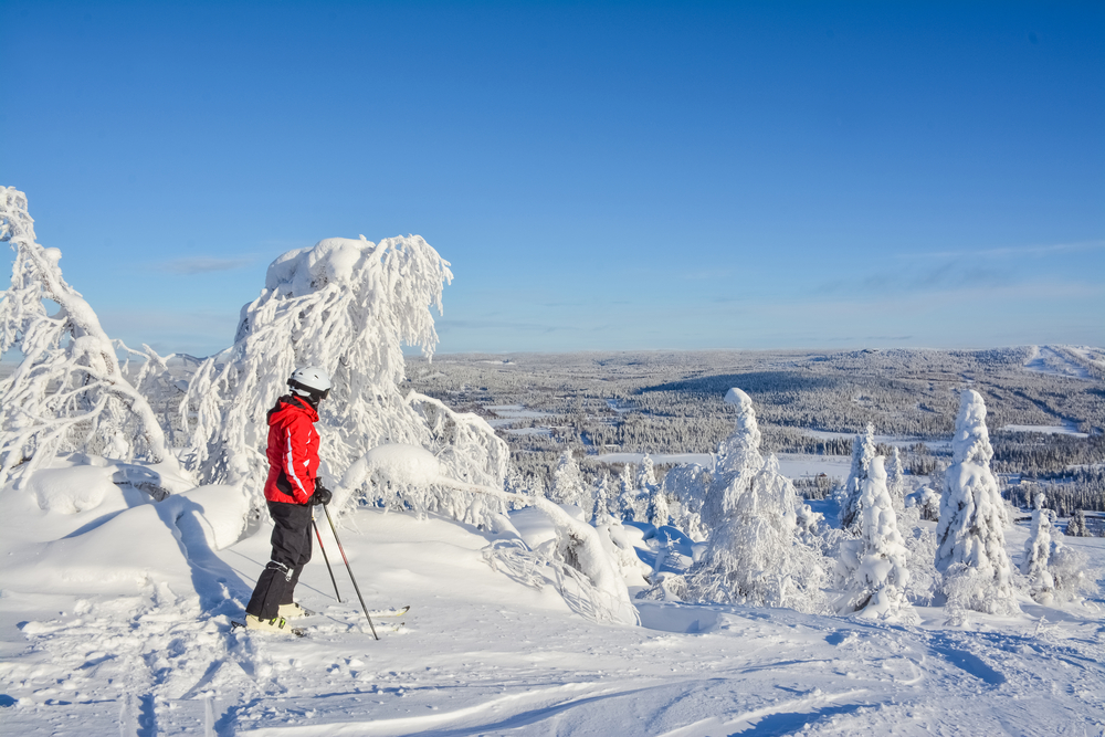 Someone in skiwear overlooking the start of a slope in Finland