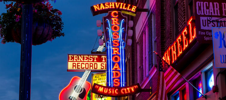 Neon signs on a street in Nashville