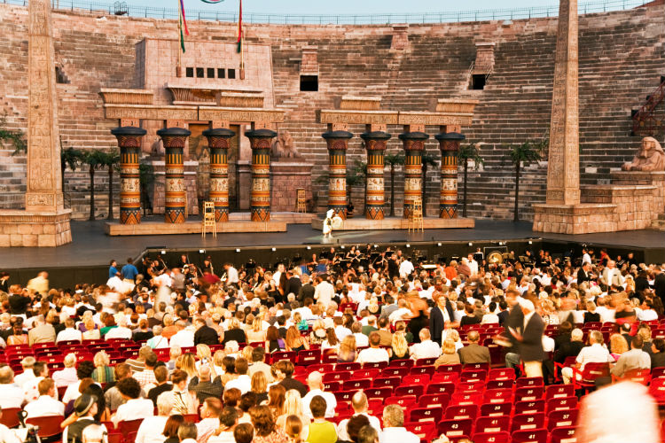 An opera show taking place in the Arena of Verona