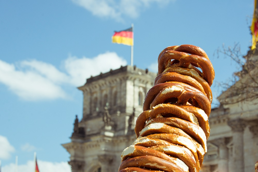 A picture of a pile of pretzels in front of a German flag