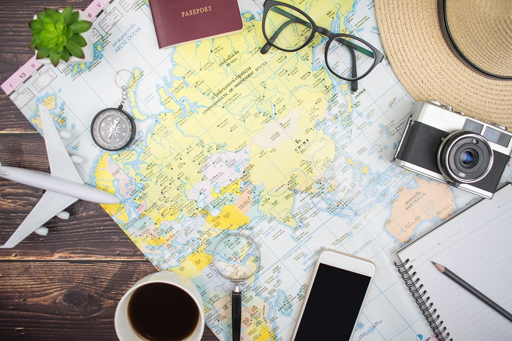 A picture of a map with a camera and a notebook
